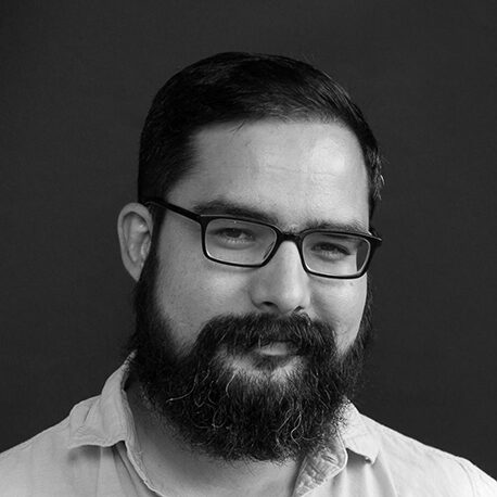 black and white photo of a bearded man in glasses